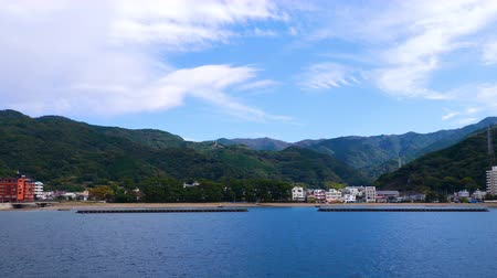 vdo : 4K VDO of mountain landscape view over blue sky and white cloud from the ferry boat in the ocean at Suruga Bay, Shizuoka, Japan
