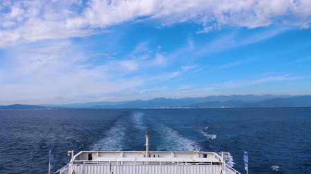 航海 : Back view and ship wake from the Suruga Bay Ferry cruise  boat at Shimizu port, Shizuoka, Japan (Water surface wave from back of ferry boat)