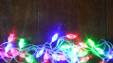 borders : Christmas light on the wooden background