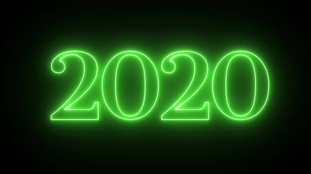 kalendarz : Happy New Year 2020 neon sign with green, pink, blue light blinking on black background.new year concept design.