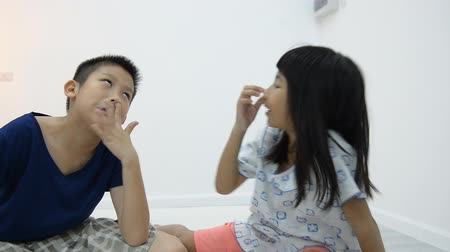 yanaklar : Asian Boy and girl picking their nose during playing together
