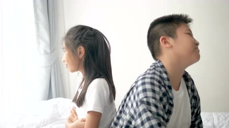 bochechudo : Arguing Asian preteen boy with his younger sister at home, lifestyle concept.