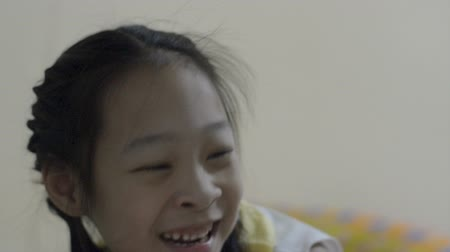 детский сад : Happy Asian laughing with her sister at home.