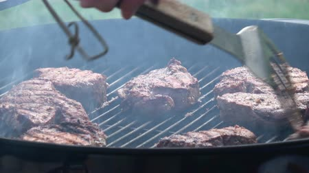 Mans hands cooking steak on grill Stok Video