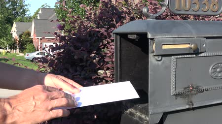 Man hand taking letter from mailbox