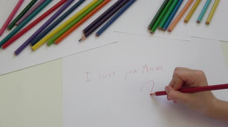 Writing I love you Mom for Mothers day 影像素材