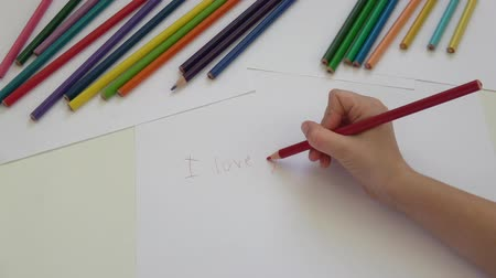 Writing I love you with red pencil