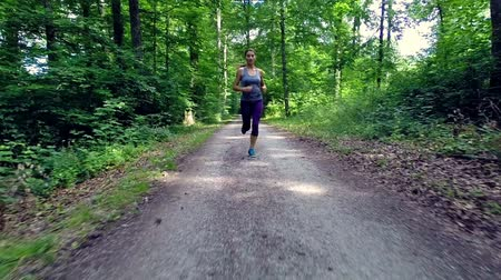 jogging : young woman jogging through forest