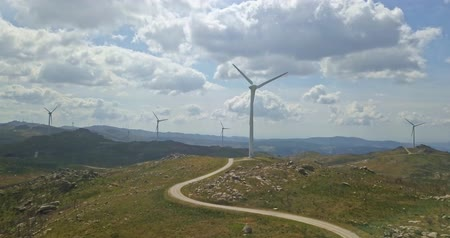 malom : Aerial view, by drone of a wind turbines on top of mountains, cloudy sky as background, in Portugal Stock mozgókép