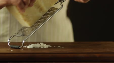Chef Grating Cheese on a Wooden Surface