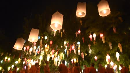 hot news : CHIANG MAI THAILAND-NOVEMBER 08 :Unidentified monks release floating lamp made of paper annually at Phan Tao temple in Loy Krathong and Yi Peng Festival on November 08,2014 in Chiangmai,Thailand Stock Footage