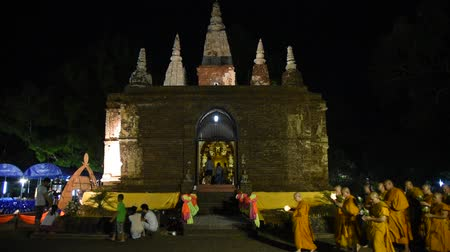 clergy : CHIANG MAI THAILAND  JUN 01: Clergy and Buddhists candle lit around mock bodh gaya pagoda in Vesak Day at Jed Yod temple on June 01 2015 in Chiang Mai Thailand.