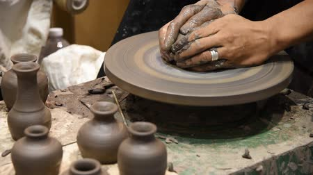 potter wheel : Hands working on pottery wheel, was produced on range of vase. Stock Footage