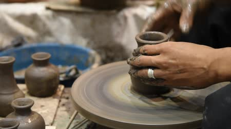 alkotás : Hands working on pottery wheel, was produced on range of vase. Stock mozgókép