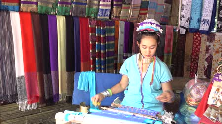 long neck karen : CHIANG MAI, THAILAND - JULY 06, 2017 :Unidentified Woman Long Neck Karen Tribal Weaving of traditional in the countryside, Chiang mai,Thailand.