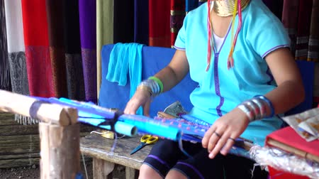 long neck karen : Woman Long Neck Karen Tribal Weaving of traditional in the countryside, Chiang mai,Thailand. video 4k