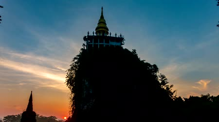surat : Time lapse Beautiful sunrise with pagoda on the top of mountain at Khao Na Nai Luang Dharma Park,Surat thani province,Thailand Stock Footage