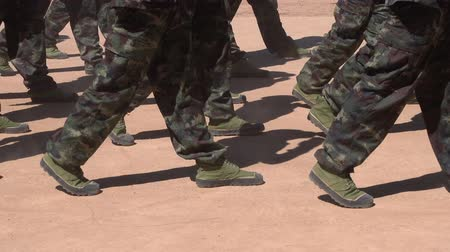 asker : Soldiers with camouflage uniform marching in formation on parade at national day. Army forces on march at anniversary.