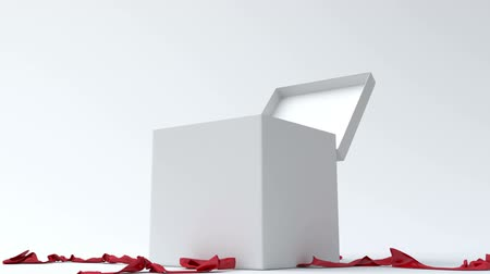 подарок : White gift box with red ribbon opening.