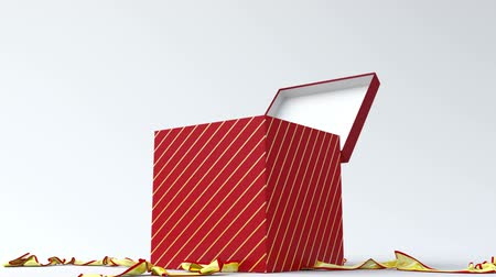подарок : Red gift box with gold ribbon opening.