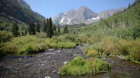 rv park : Maroon Bells and stream, Rocky Mountains, Colorado - HD video Stock Footage