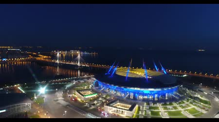 largest city : Stadium Zenith Arena at night. Illuminated by multi-colored lights the stadium at night Stock Footage
