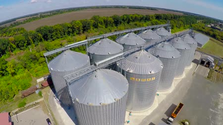 corrugated : Flight of the grain terminal from the drone. The grain plant for storage and drying of grain. Grain terminal. Plant for the drying and storage Rice plant in the middle of fields.