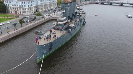 water cannon : Cruiser Aurora in the River Neu, the city of St.Petersburg. Open to tourists. The symbol of the revolution of 1917. Stock Footage