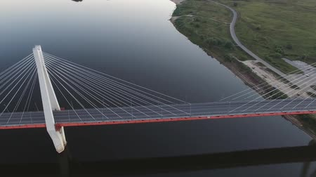 new town : Beautiful bridge over the river. The bridge on the cables is road. Stock Footage