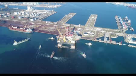 Drilling platform in the port. Towing of the oil platform.