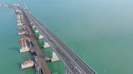 murals : Crimean bridge before the opening of traffic on it. Grandiose construction through the Kerch Strait. Megastore. Construction of the bridge. Engineering facilities for the construction of a railway and automobile bridge across the strait. Stock Footage