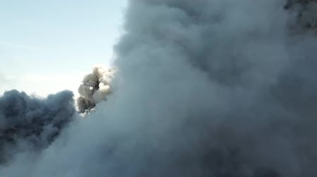 gush : Smoke from the mouth of the volcano. Eruption. Clubs of smoke and ash in the atmosphere. Stock Footage
