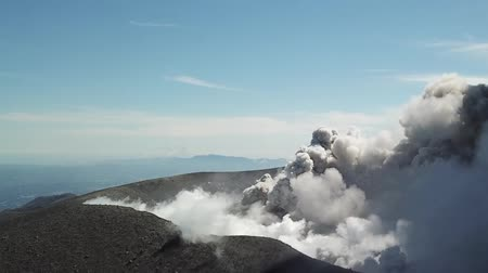 sediments : Smoke from the mouth of the volcano. Eruption. Clubs of smoke and ash in the atmosphere. Stock Footage