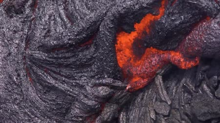 erupt : Current lava on the surface of the earth. Liquid lava.