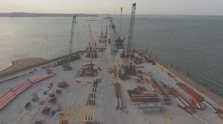 The construction of the Crimean bridge, the middle of the construction site. building machinery and building materials. Tower cranes and piles.