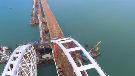 paving : Arch of the Crimean bridge. Construction of the Crimean bridge. Grandiose construction in the Kerch Strait. Stock Footage