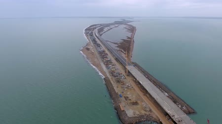 Construction of the Crimean bridge, view from the drony on top of the construction site in the Kerch Strait. Dostupné videozáznamy
