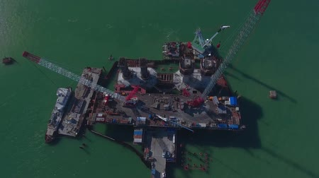 Construction of the Crimean bridge, view from the drony on top of the construction site in the Kerch Strait. Wideo