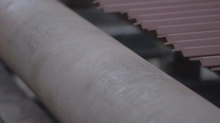 dockyard : Steel corners on a rolling machine. Metal rolling. Stock Footage