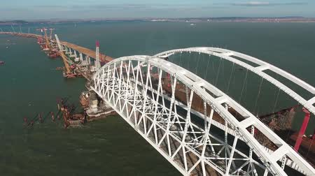 putin : Construction of the Crimean bridge. The process of building a bridge. Assembling spans and arches of the bridge. Stock Footage