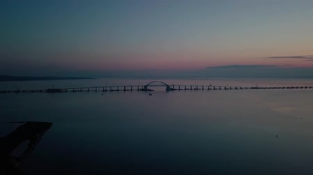 paving : Construction of the Crimean bridge. The process of building a bridge. Assembling spans and arches of the bridge. Stock Footage