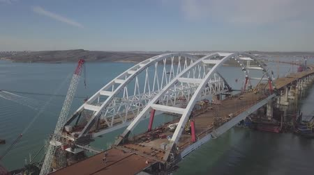 unfinished : Construction of the Crimean bridge. The process of building a bridge. Assembling spans and arches of the bridge. Stock Footage
