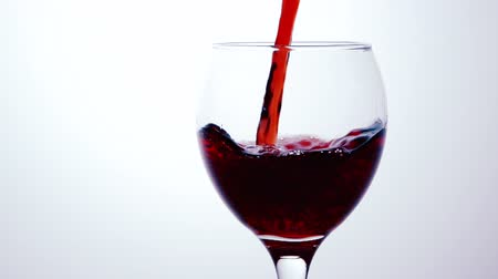 Бордо : Red Wine Pouring into Glass. White Background.