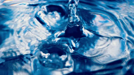 derűs : Water drop falling down. Slow motion Stock mozgókép