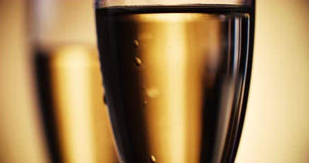 cheers : Champagne is poured into the glasses. Slow motion. 4K. Stock Footage