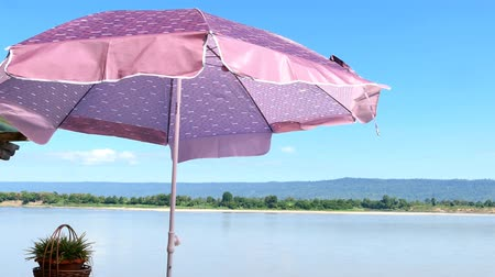 Video , River view in quiet summer blue sky, wind, sunshine and colorful umbrellas .