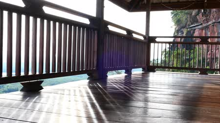 A wooden balcony with light in the morning. Quiet, suitable for relaxing. Video
