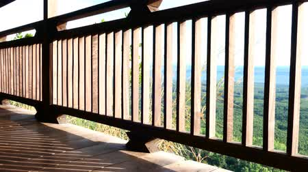 erkély : A wooden balcony with light in the morning. Quiet, suitable for relaxing. Video
