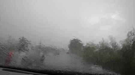 video footage ,Driving on a rainy highway,  Rain on windshield.inside the car .