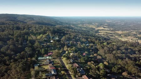 pan shot : Aerial view over Bowen Mountain village with Kurrajong farmland and Blue Mountains foothills
